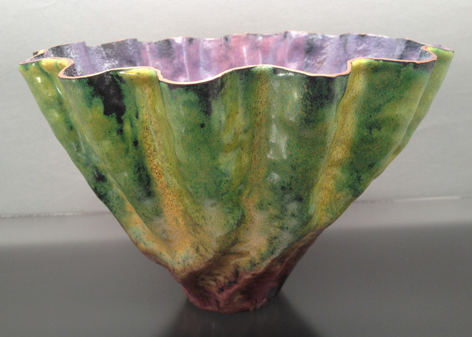 "A ceramic bowl titled ""art in bloom"""