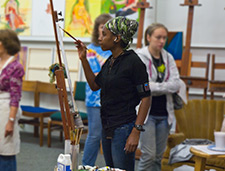 Students paint in a studio