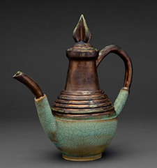 A picture of a ceramic and copper teapot