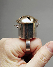 A ring that looks like a cooking pot