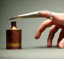 A picture of a metalworked quil finger attachment
