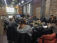 individuals meeting at the Paducah School of Art and Design